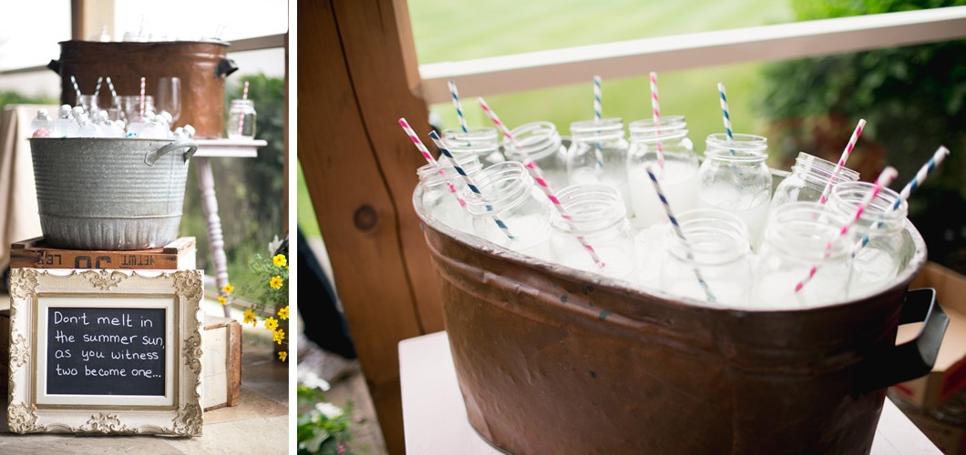metal buckets with ice and refreshments with jars and straws for wedding party